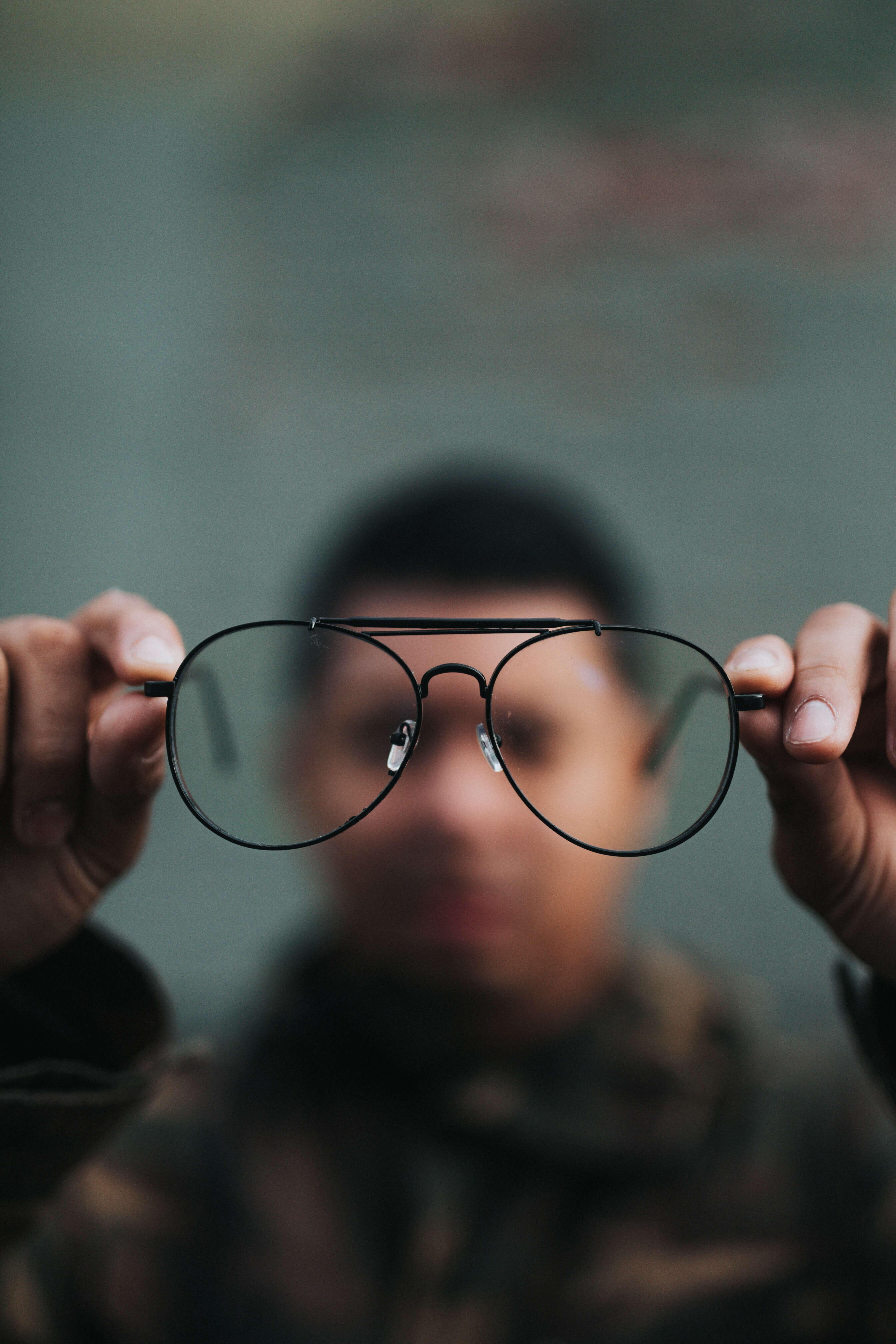 Man looks through steamed glasses