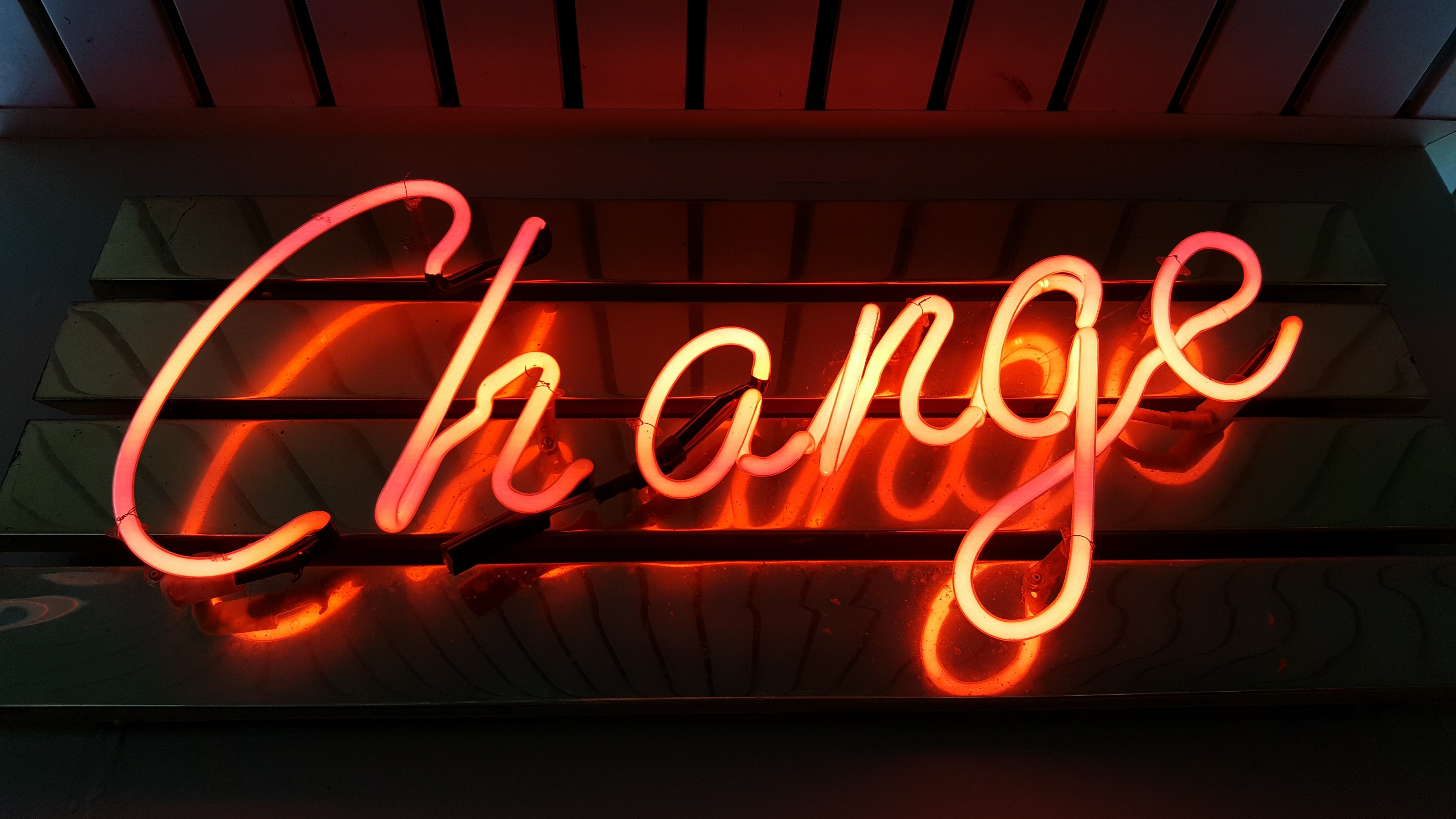Neon sign which says 'Change'
