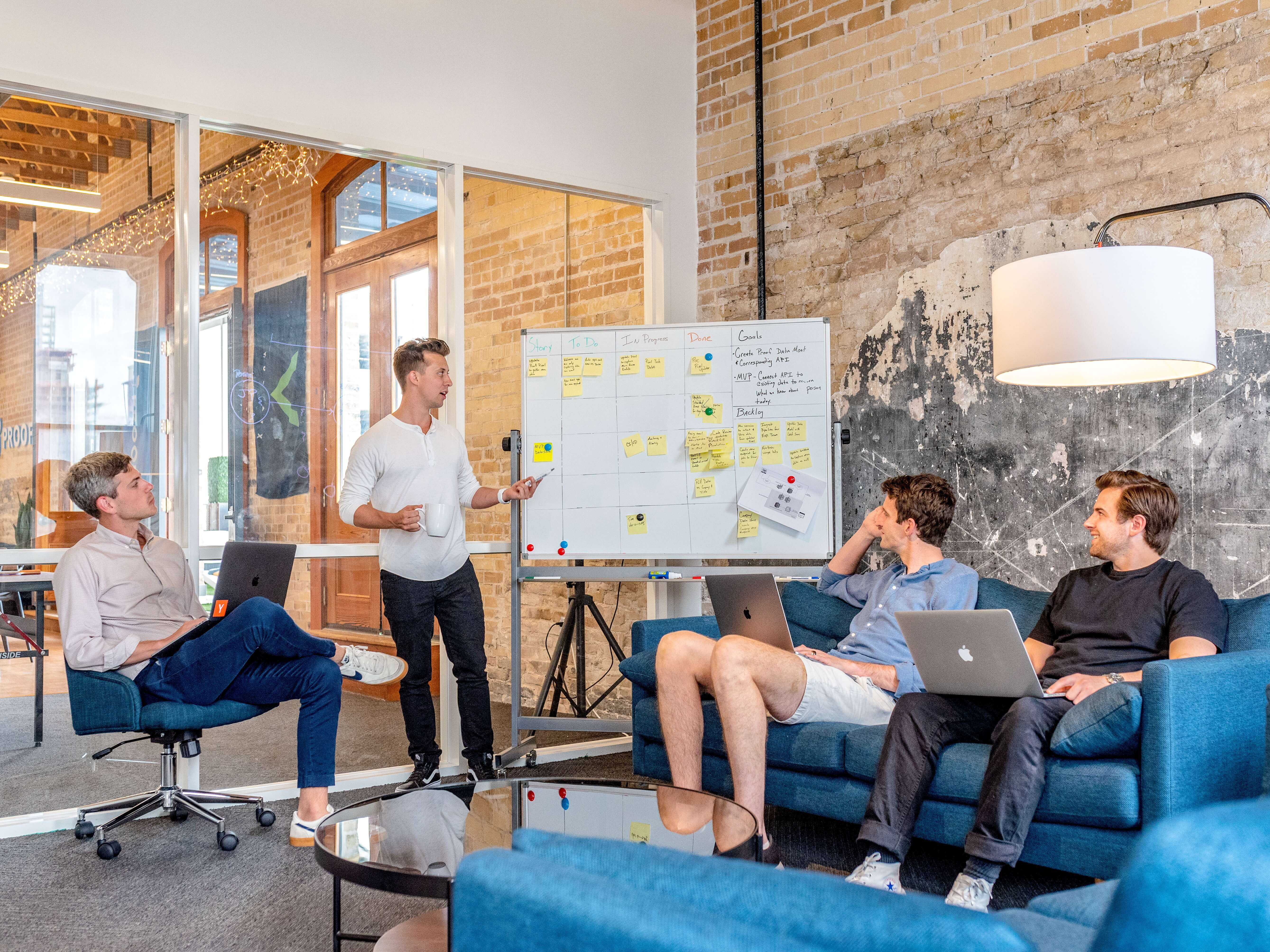 A team discuss ideas on a white board