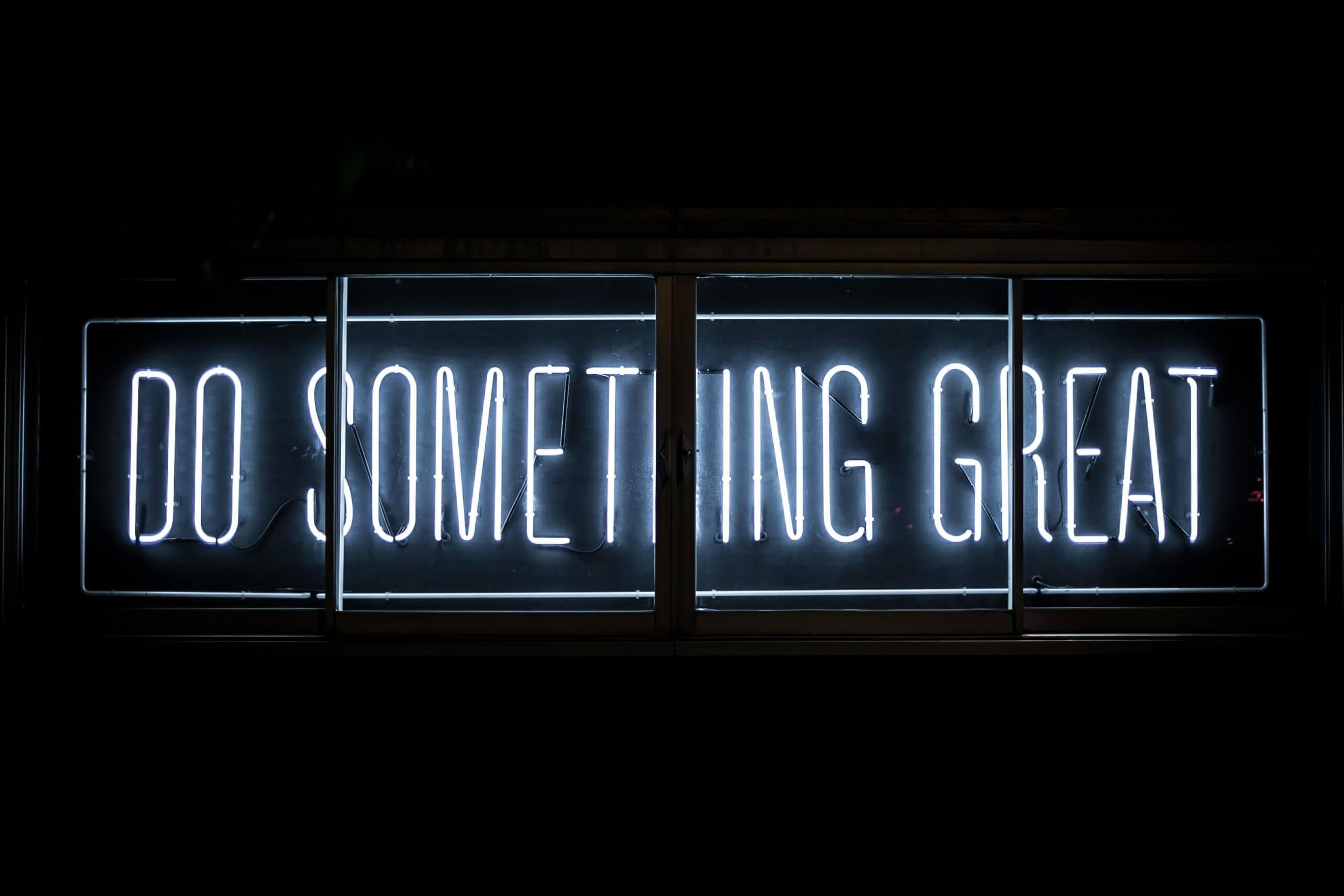 Neon sign saying 'Do something great'