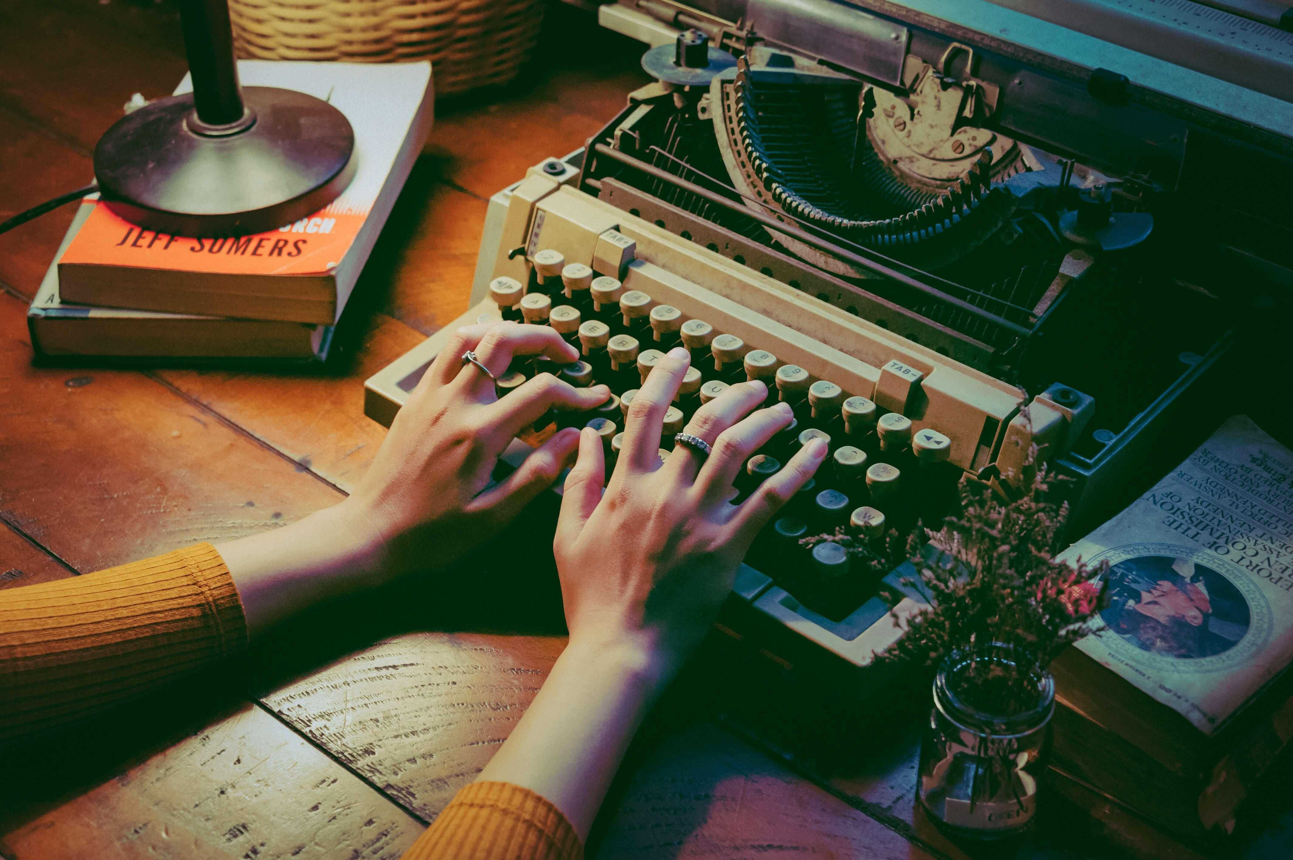 Woman using typewriter