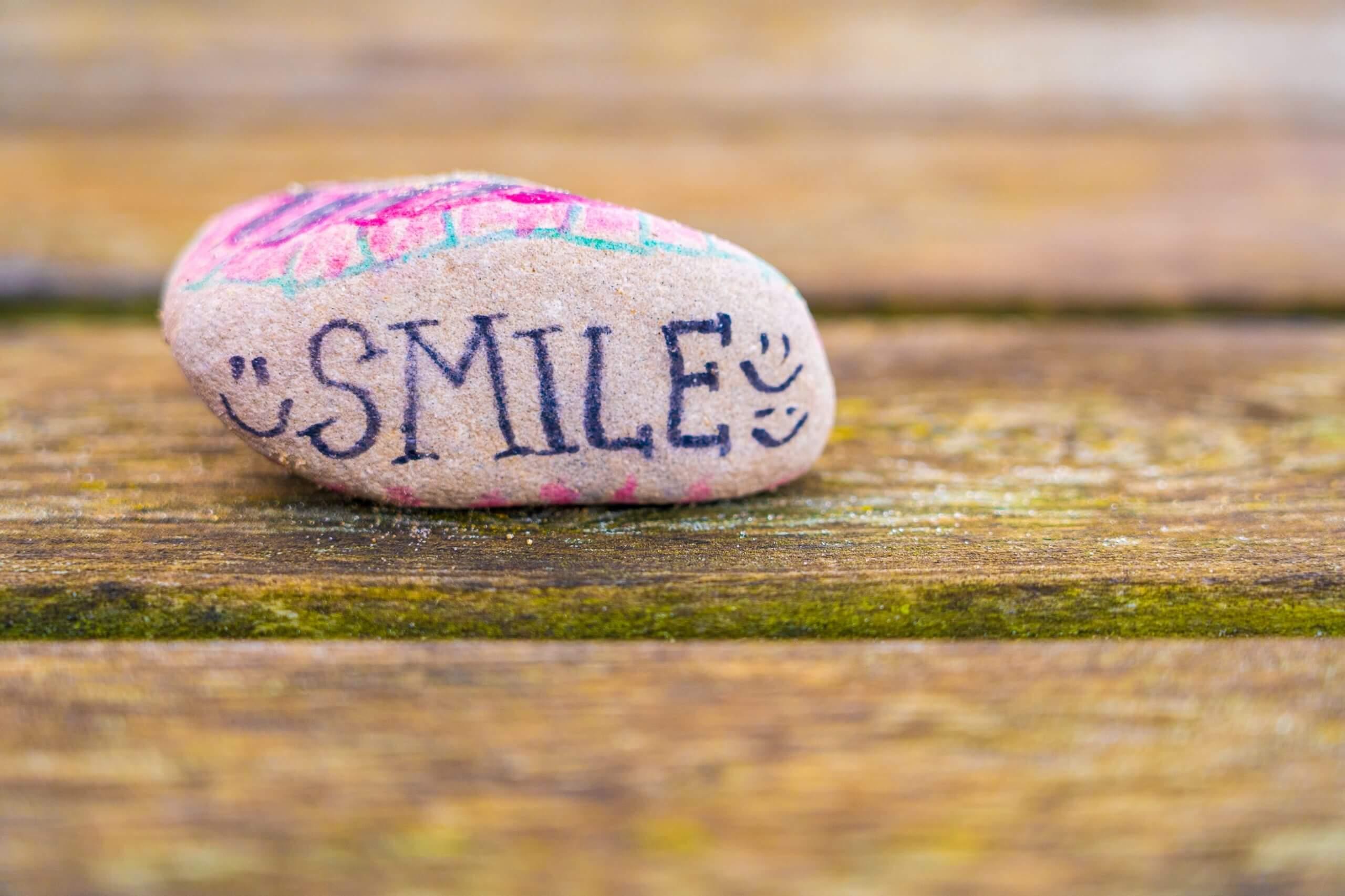 Rock saying 'smile'